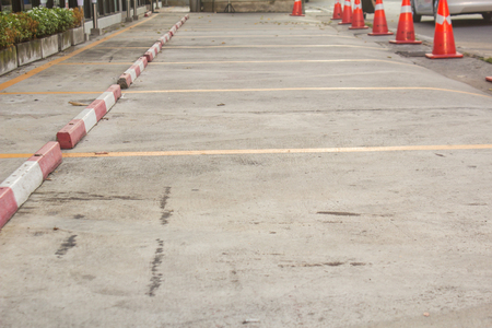 Parking area is divided into compartments with yellow lines, in Chiang Mai, Thailand. Stock Photo