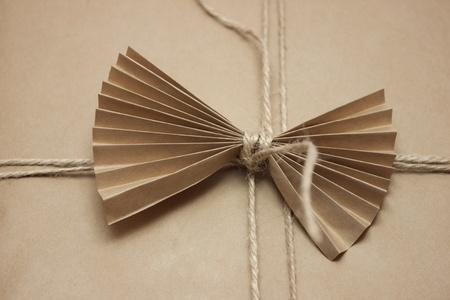 Vintage gift design with a paper bow Stock Photo
