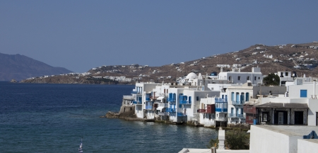 View on mysterious Mykonos city and a sea, Greece