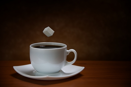 sooth: sugar cube being dropped into coffee