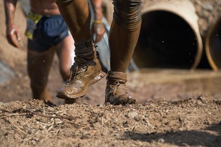 mud: Mud race runners Stock Photo