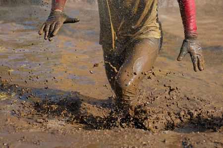 muddy: Mud race runners Stock Photo