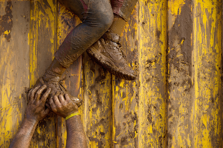 Mud runners race assistance for breakthrough