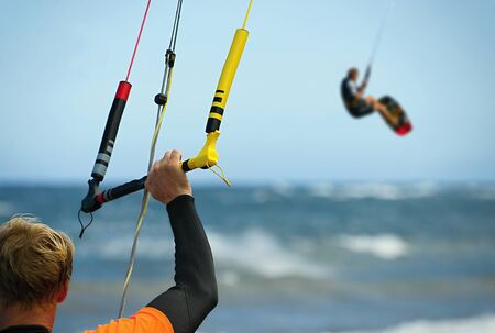 surfing: A young man ready for kite surfing kitesurfer rides in blue sea Stock Photo