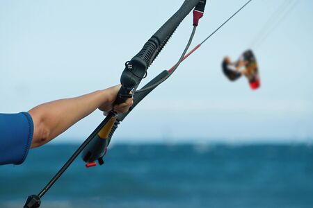 kite surfing: ready for kite surfing kitesurfer rides in blue sea