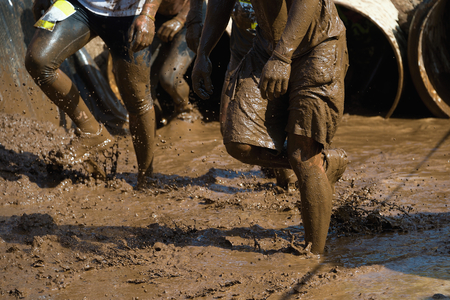 of course: Mud race runners Stock Photo