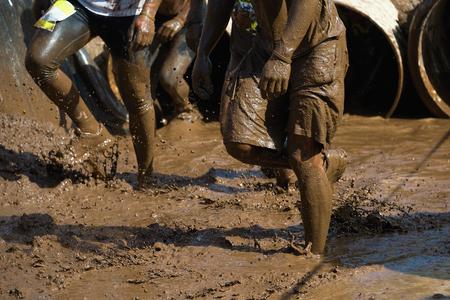 Mud race runners Imagens