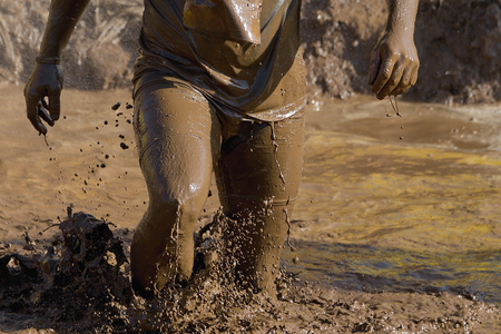 obstacle: Mud race runners Stock Photo