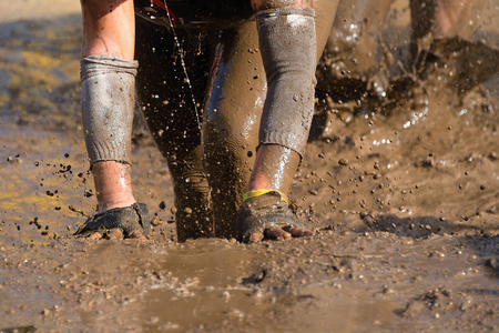 Mud race runners Stock Photo