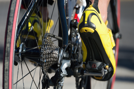velo: Cycling racing- bike detail on gear wheels and feet