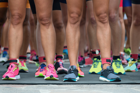 woman foot: Athletes waiting at marathon start line