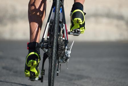 Racing- bike detail on gear wheels and feet