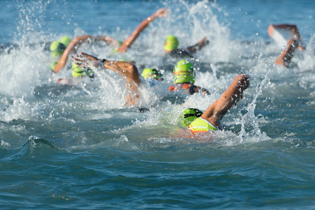 Group people in swimming at triathlon wetsuit