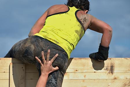 Mud runners race Racing- Helps When overcoming hindrances 写真素材