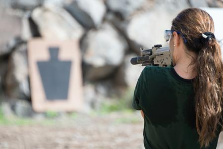 sniper training: Young women training with gun