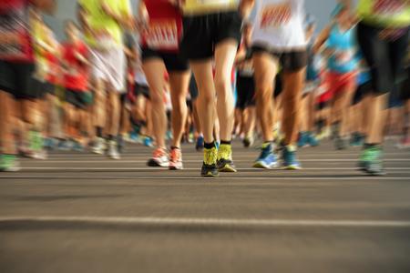 Marathon running in the light of evening,abstract