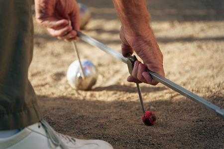 petanque: Petanque game,measuring the distance, deciding whos the winner