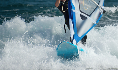 slight: Windsurfer moving on the waves of slight stormy sea