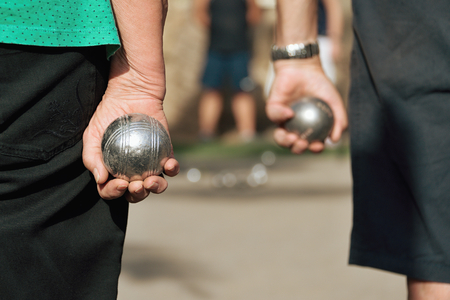 bocce ball: seniors playing the french game petanque