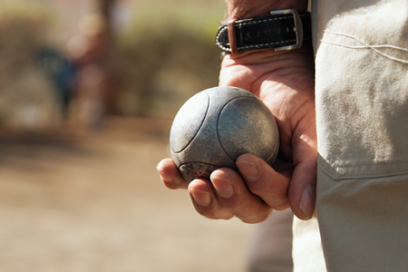 petanque: Senior playing petanque,fun and relaxing game