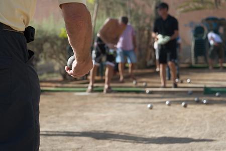 petanque: Senior playing petanque, balls on the ground