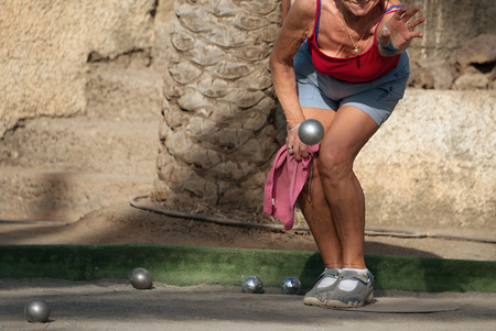 bocce ball: Senior woman playing petanque Stock Photo