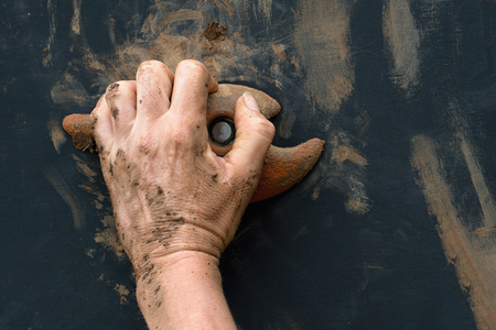 grasping: Mud race runners,hand grasping onto a wall climbing handhold Stock Photo