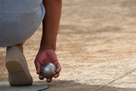 chrome ball: Senior playing petanque,fun and relaxing game