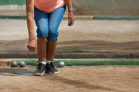 bocce ball: Senior playing petanque, balls on the ground