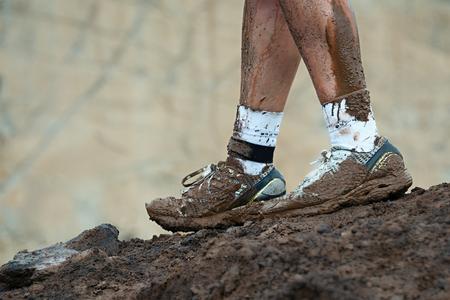 muddy: Mud race runners,muddy running shoes