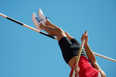 Athlete pole vault with a blue sky Stock Photo