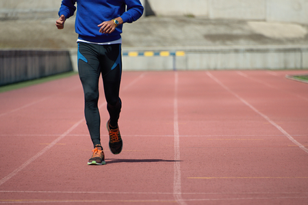 pace: Athlete runner running on athletic track Stock Photo
