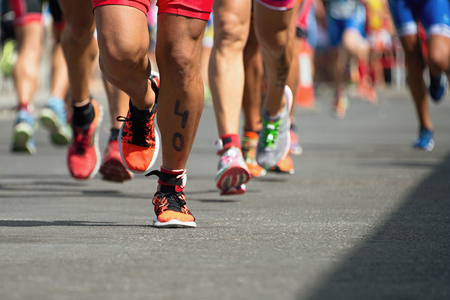 Marathon competition during an ironman the numbers on the leg Zdjęcie Seryjne