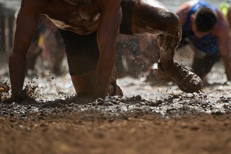 Mud race runners Standard-Bild