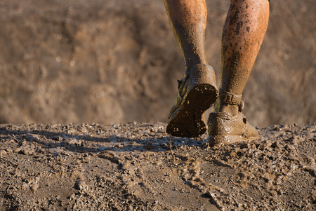 Mud race runners,detail of the legs