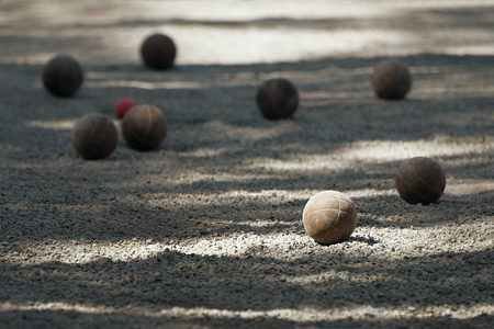 metal ball: Petanque ball boules bawls on a dust floor
