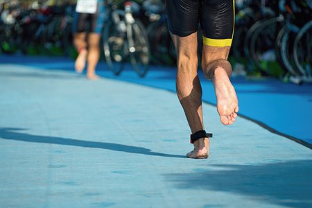 triathlete: Running triathlete in the transition zone, runner after swimming