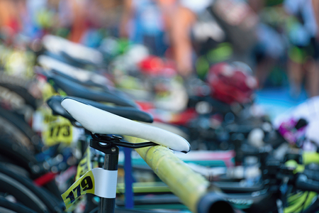 Triathlon the transition zone.Bicycles at triathlon change over station. Stok Fotoğraf
