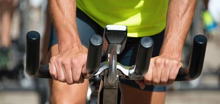 stationary bicycle: Active people working out on exercise stationary bicycle