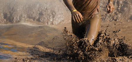 Mud race runners,man running in mud