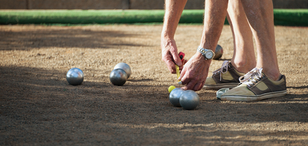 Petanque game,measuring the distance, deciding who's the winner 写真素材