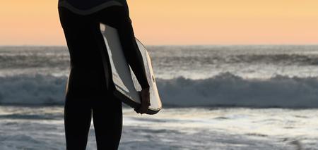 bodyboard: Silhouette surfer bodyboard man on beach at sunset,male body surfer