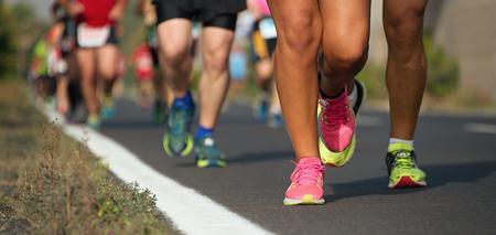 Marathon running in the light of evening Stock Photo