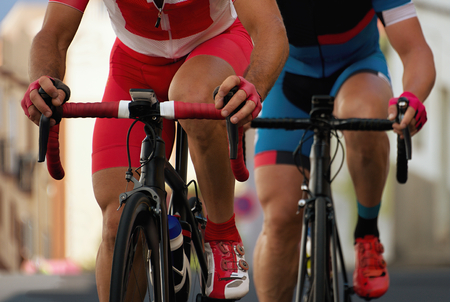 Cycling competition,cyclist athletes riding a urban race Stock Photo