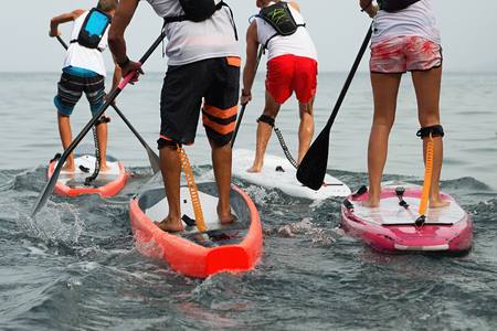 Stand up paddle group on the sea Stock Photo