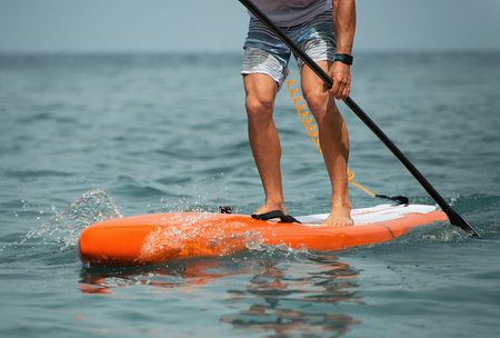 Stand up paddle board man paddleboarding on ocean