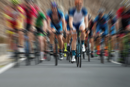 Cycling competition,cyclist athletes riding a race at high speed,abstract
