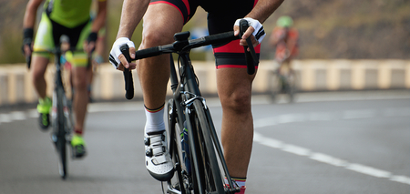 road position: Cyclists with racing bikes during the cycling road race Stock Photo