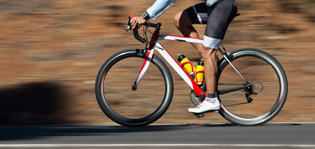 Motion blur of a bike race with the bicycle and rider at high speed