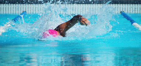 Male swimmer in an outdoor swimming pool,swimmer in blue pool water Stock Photo